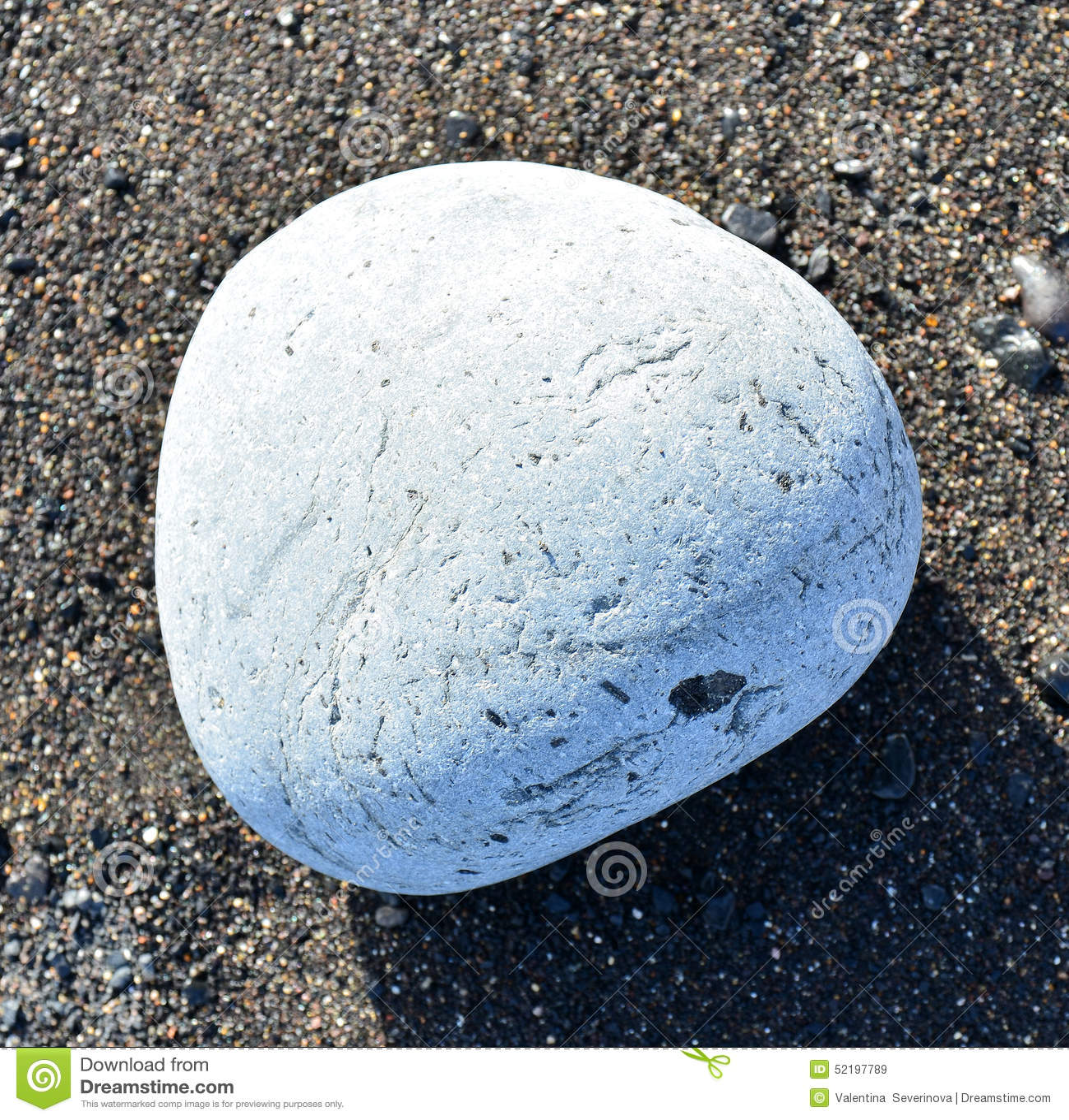 Large White Granite Rock : White stone on a dark sand stock photo image