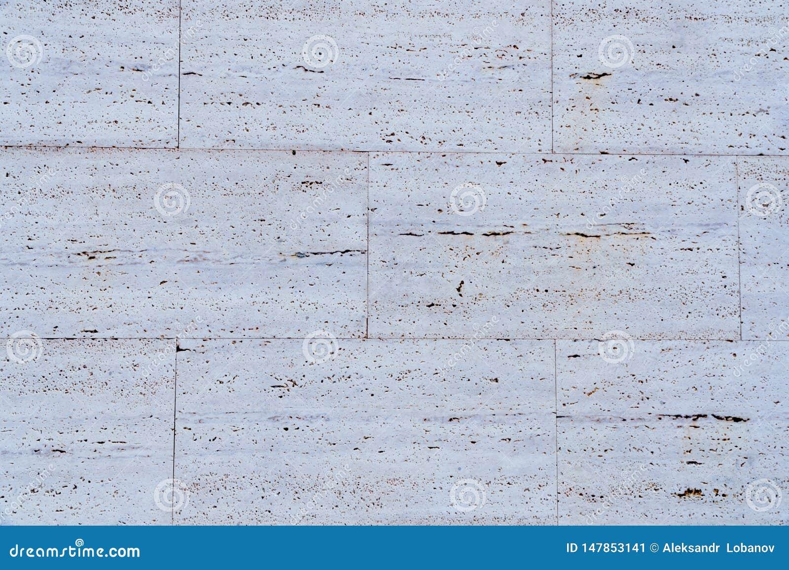 White stone wall texture on street