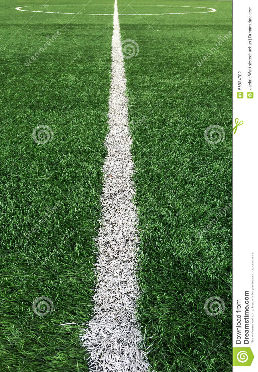 White Stripe Line To Center Of The Green Soccer Field Used As