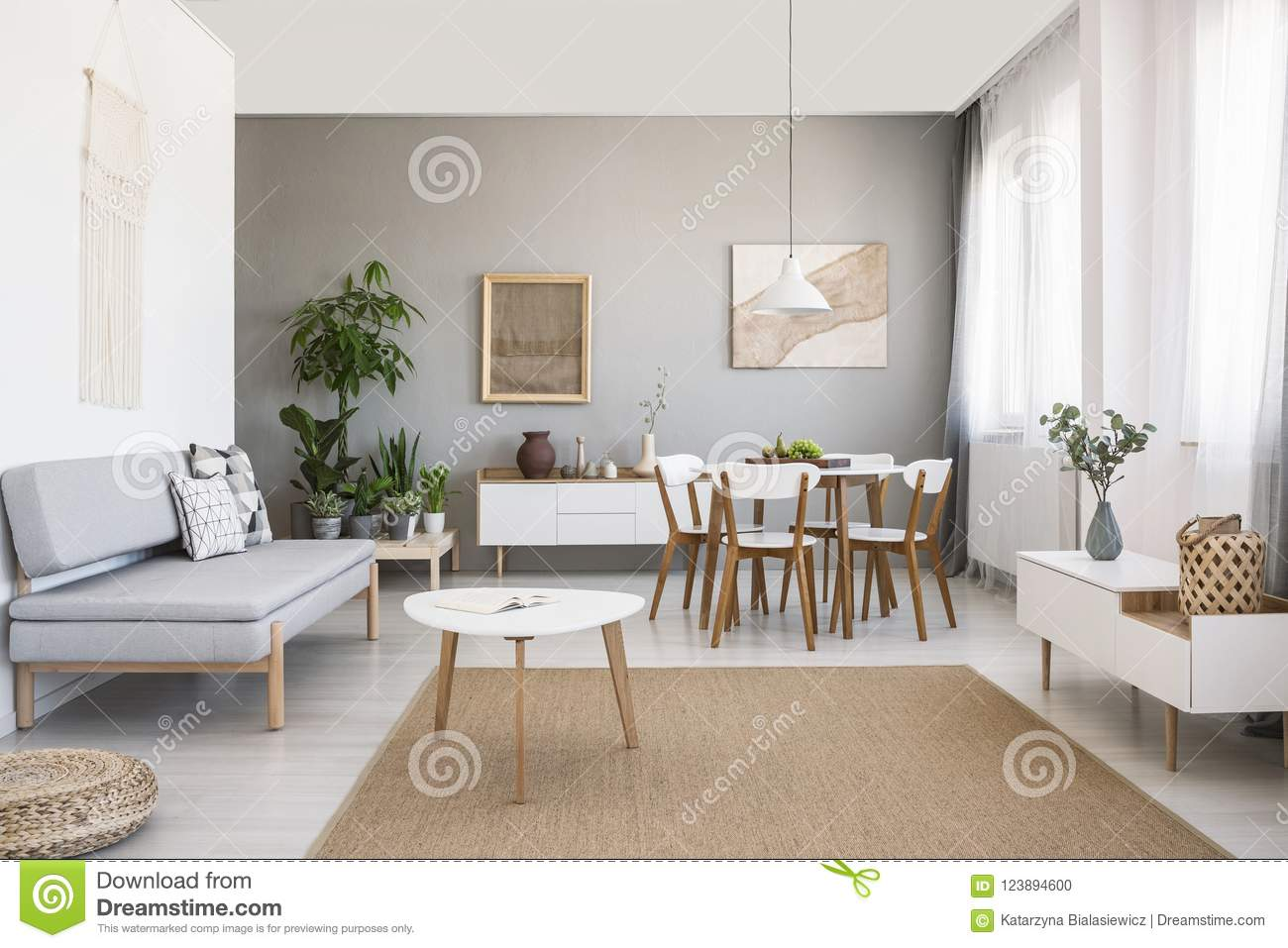 White Table On Brown Carpet In Living Room Interior With ...