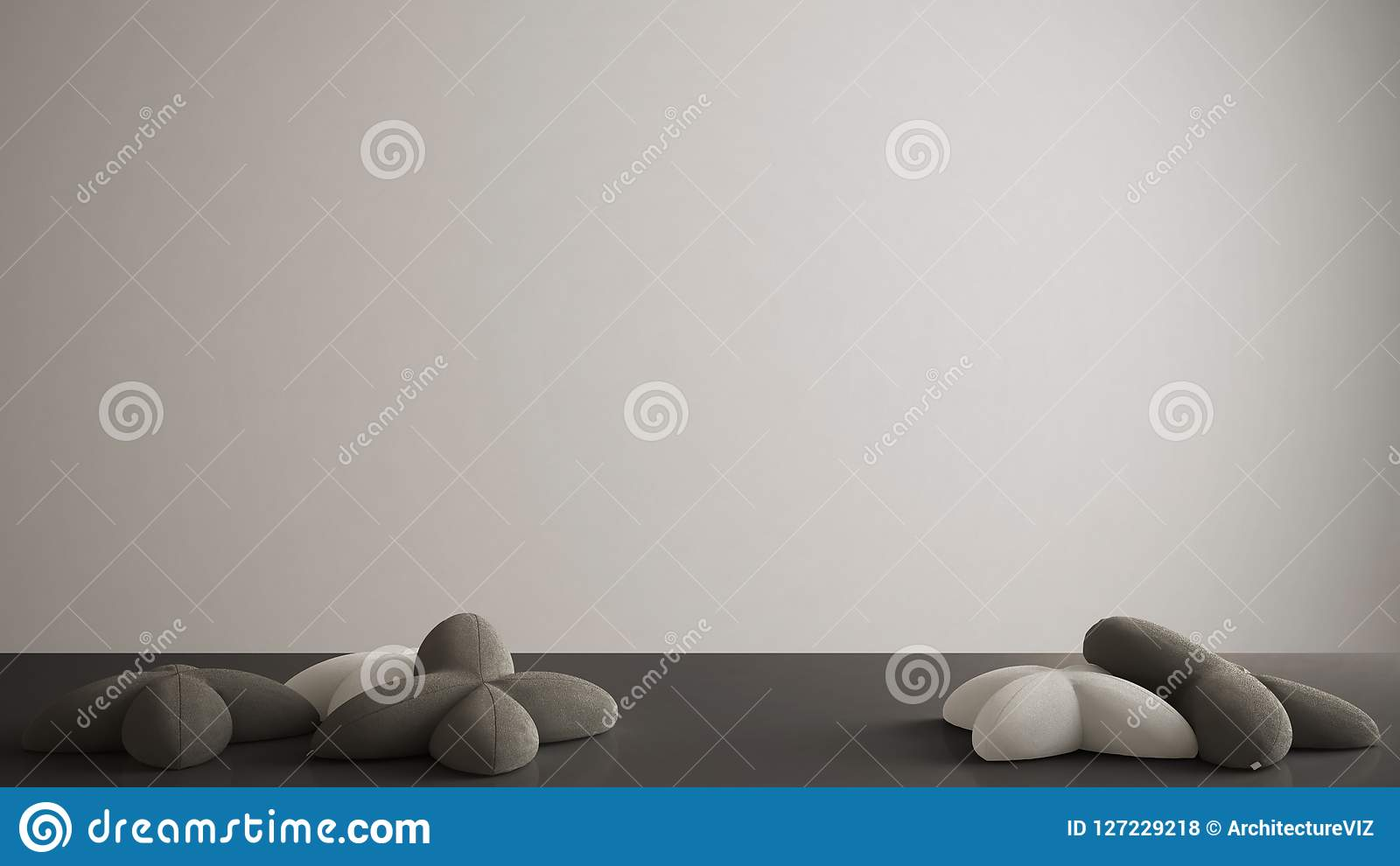 White table, desk or shelf with five soft gray and black pillows in the shape of stars, blank background with copy space, interior