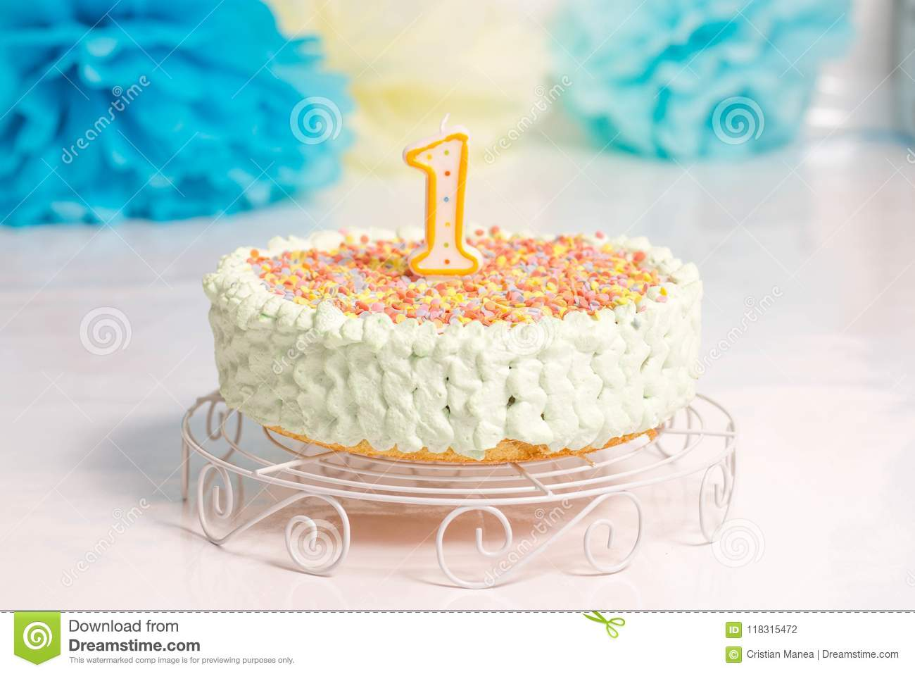 A White Table Holding Birthday Cake For 1 Year Old Child Is Round And Has Big Number One On Top Background Smash The Party