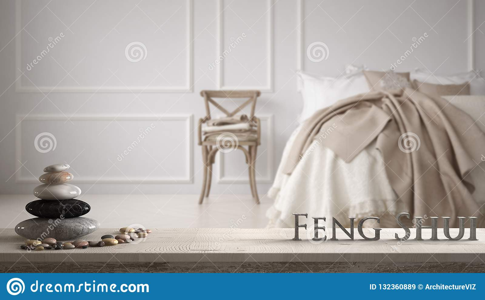 White table shelf with pebble balance and 3d letters making the word feng shui over evintage classic bedroom with soft bed full of