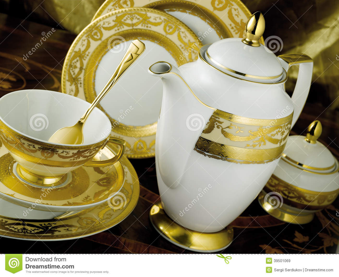 White tableware set with gold trim