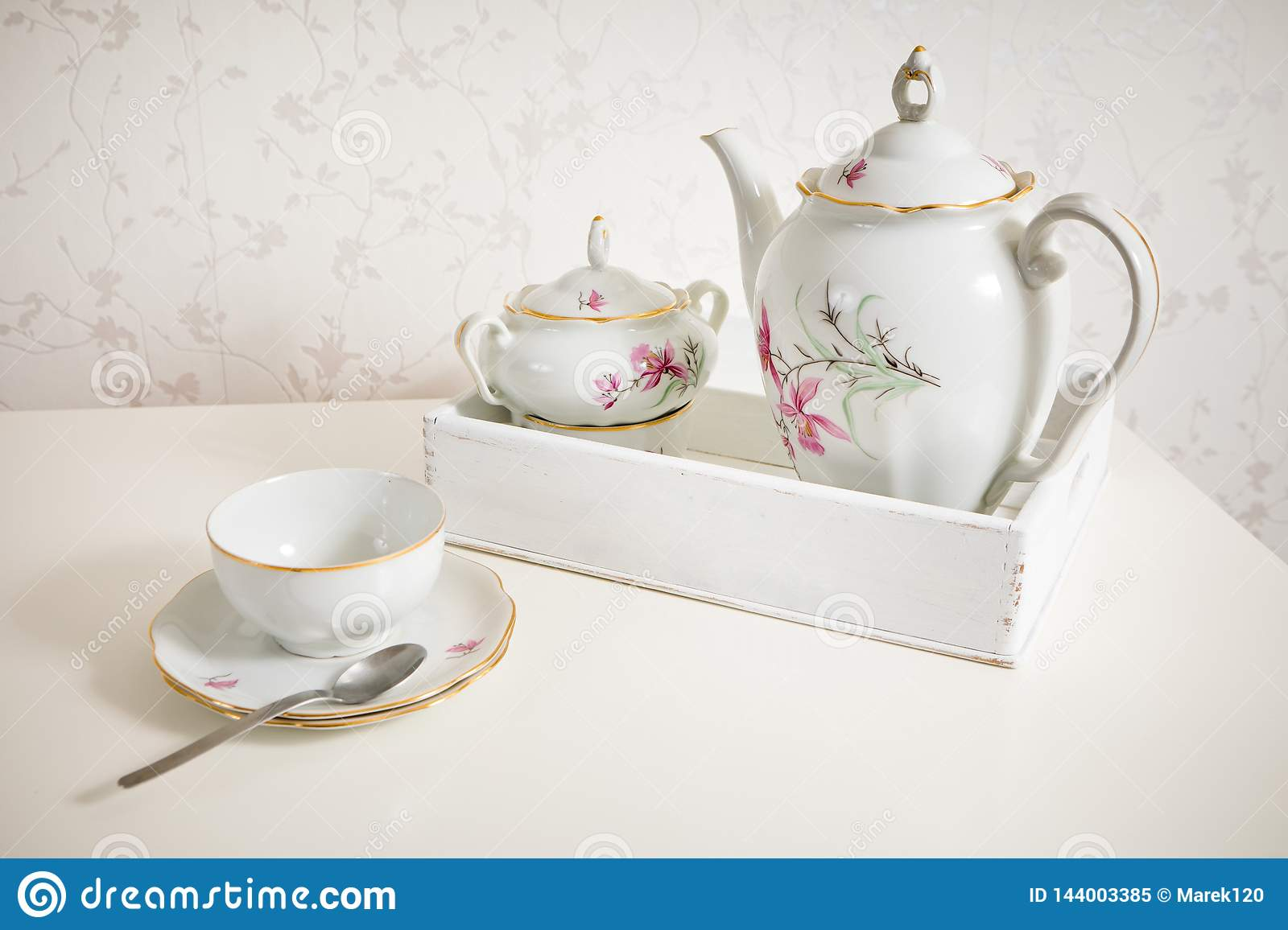 White tea service on white commode ready for use. Start a morning with cup of tea or coffee