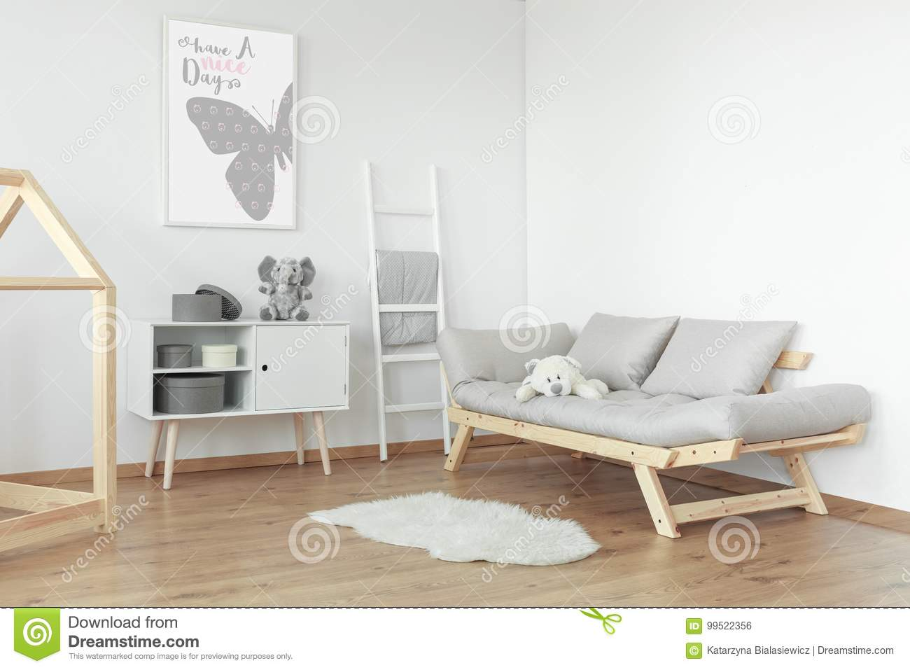 White teddy bear on grey sofa