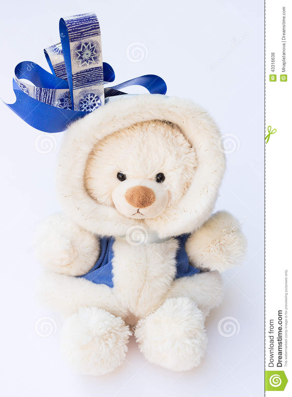 white teddy bear in a winter coat with a big blue ribbon. Black Bedroom Furniture Sets. Home Design Ideas