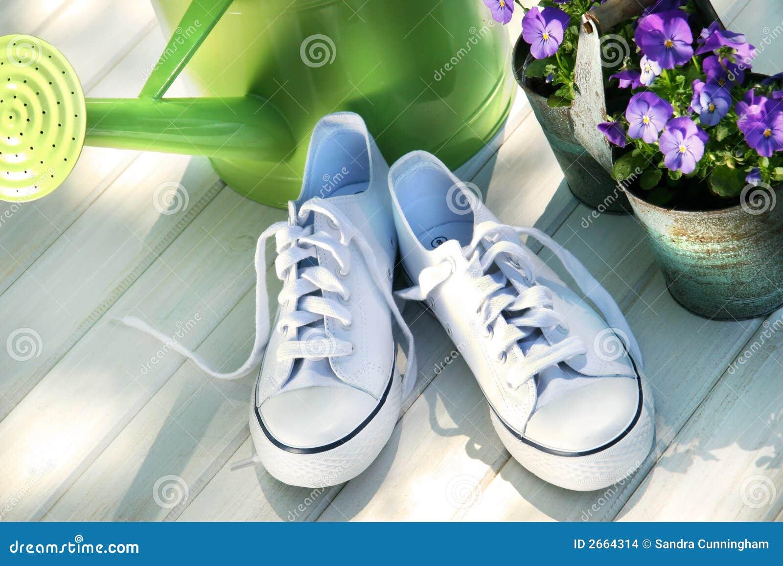 White tennis running shoes
