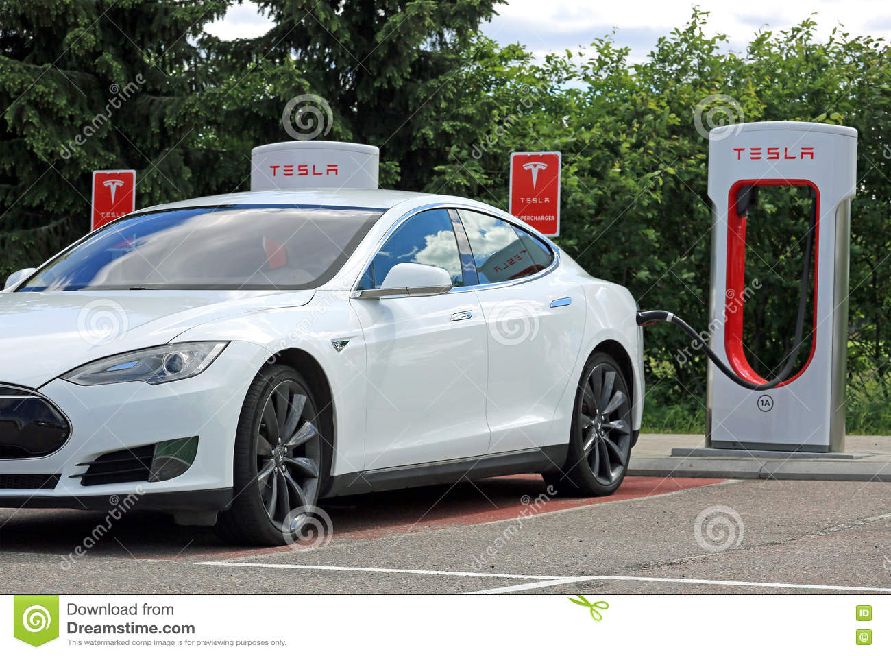 White Tesla Model S Electric Car Charging Battery Editorial Image