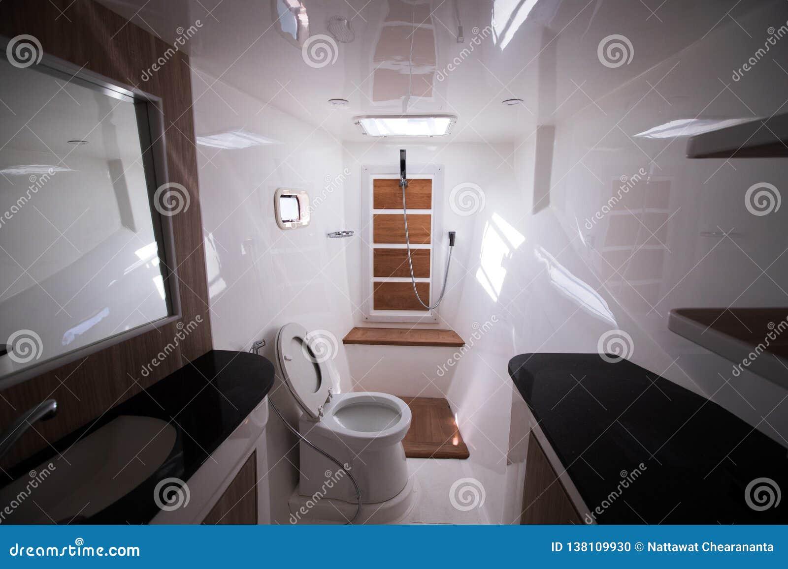 White Toilet restroom inside Yacht cruise windows