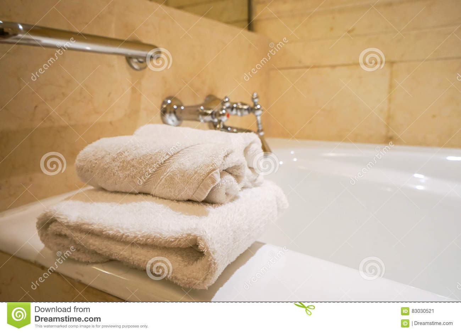 White towel on bathtub in hotel bathroom
