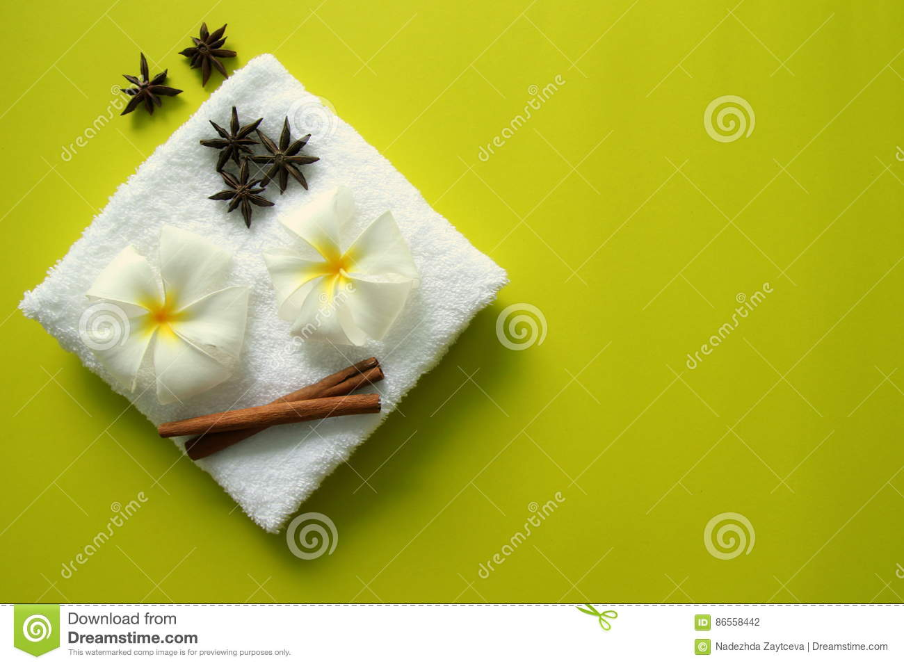 White Towel With Flowers Of Plumeria With Stars Of Anise And