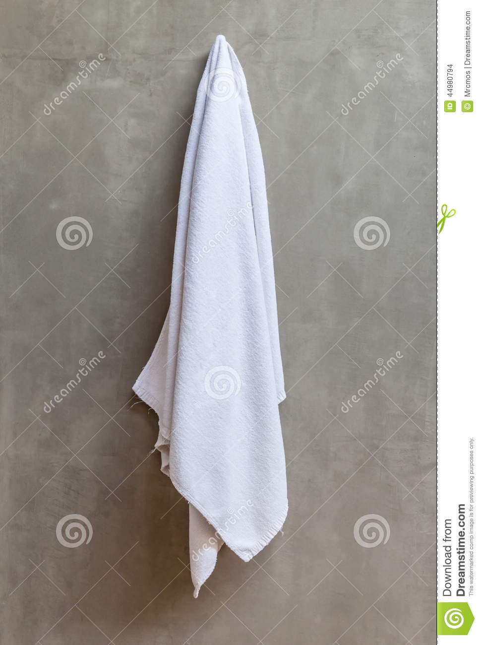 The White Towel Is Hanging On A Hanger With Concrete Wall ...