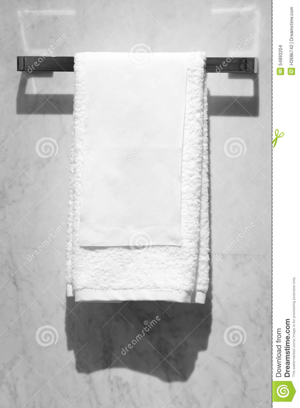 White Towel Hanging On A Marble Wall In A Bathroom Stock Photo - Image ...