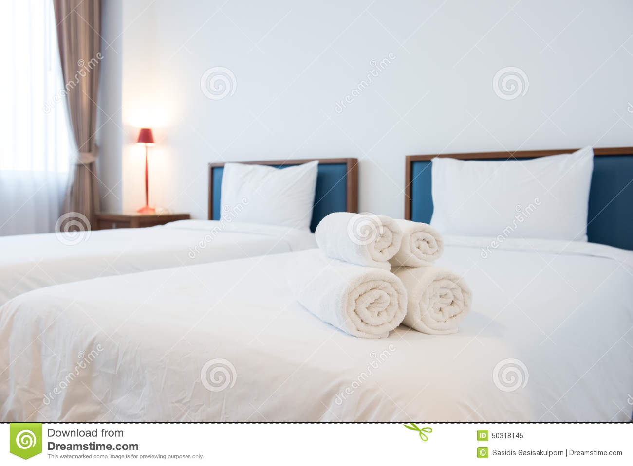 White towels on bed in hotel room stock photo image 50318145 - Beautiful snooze bedroom suites packing comfort in style ...