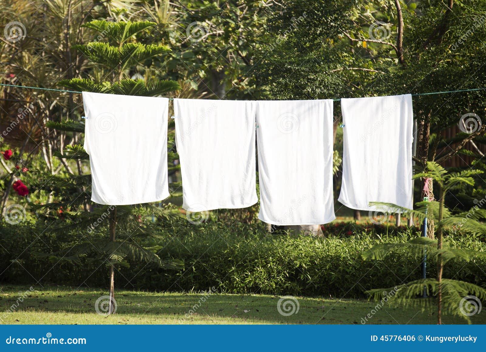 White towels drying on washing line stock photo image 45776406 - Wash white sheets keep fresh ...