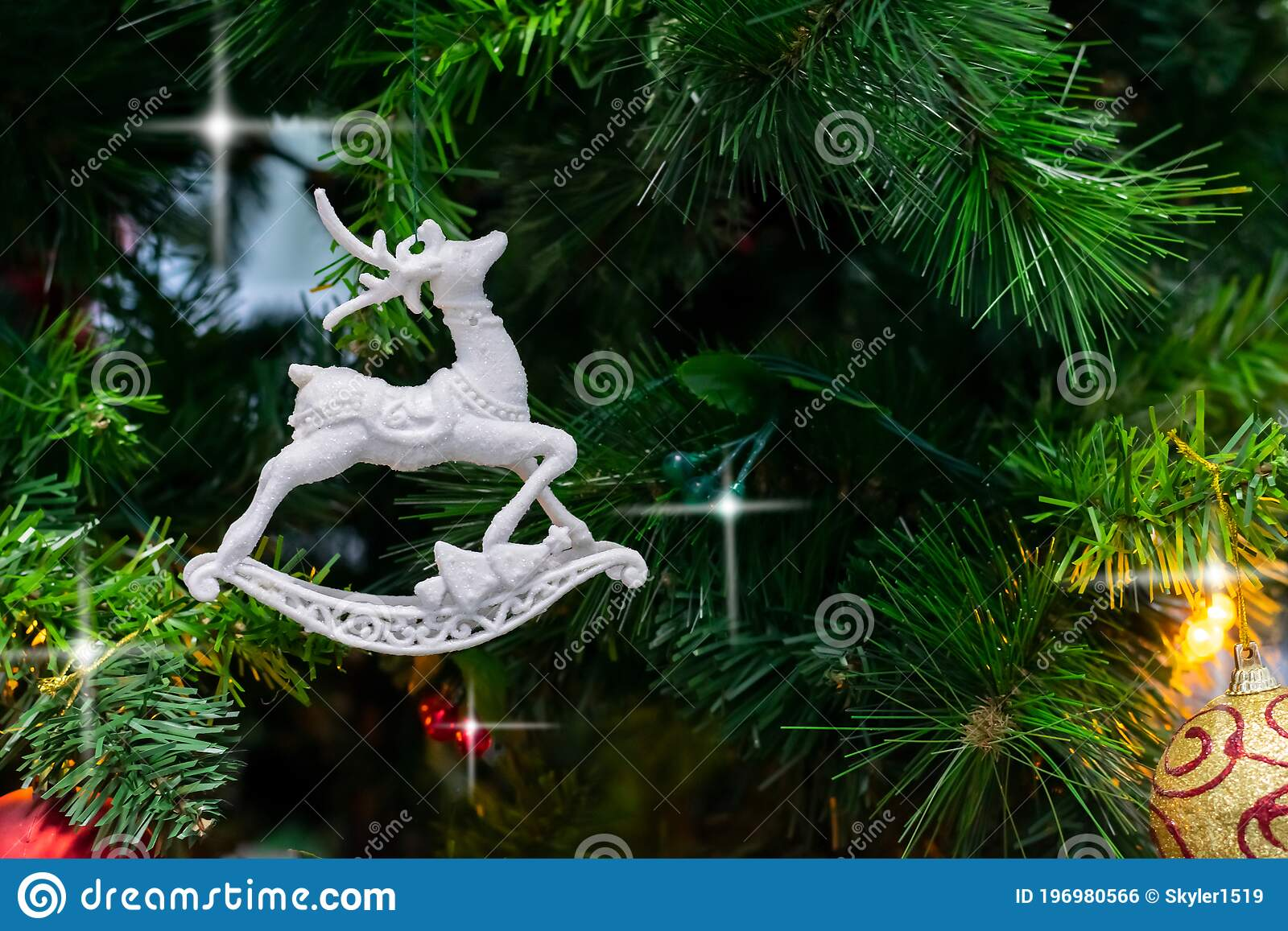 White Toy Deer Garland Ribbons Are Hanging On Branches Of Christmas Tree Stock Photo Image Of Background Nature 196980566