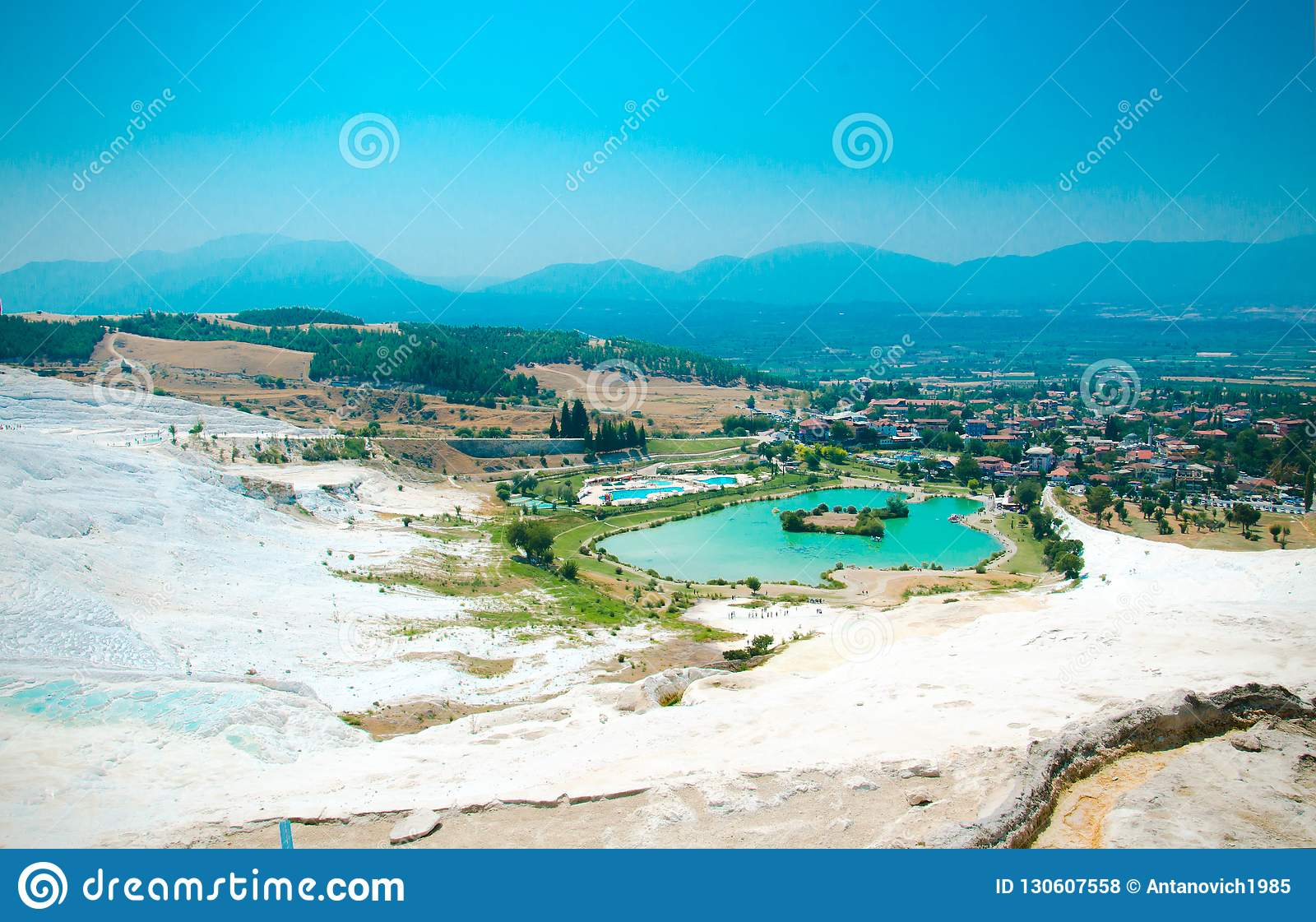 White travertine pools and terraces, turquoise lake, Pamukkale,