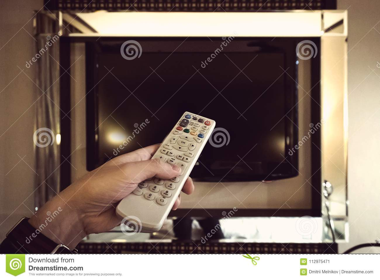tv remote control in the hand