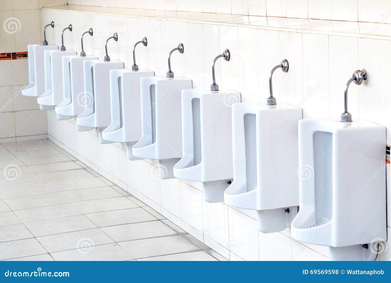 White urinals in men39s bathroom stock photo image 69569598 for Men in bathrooms
