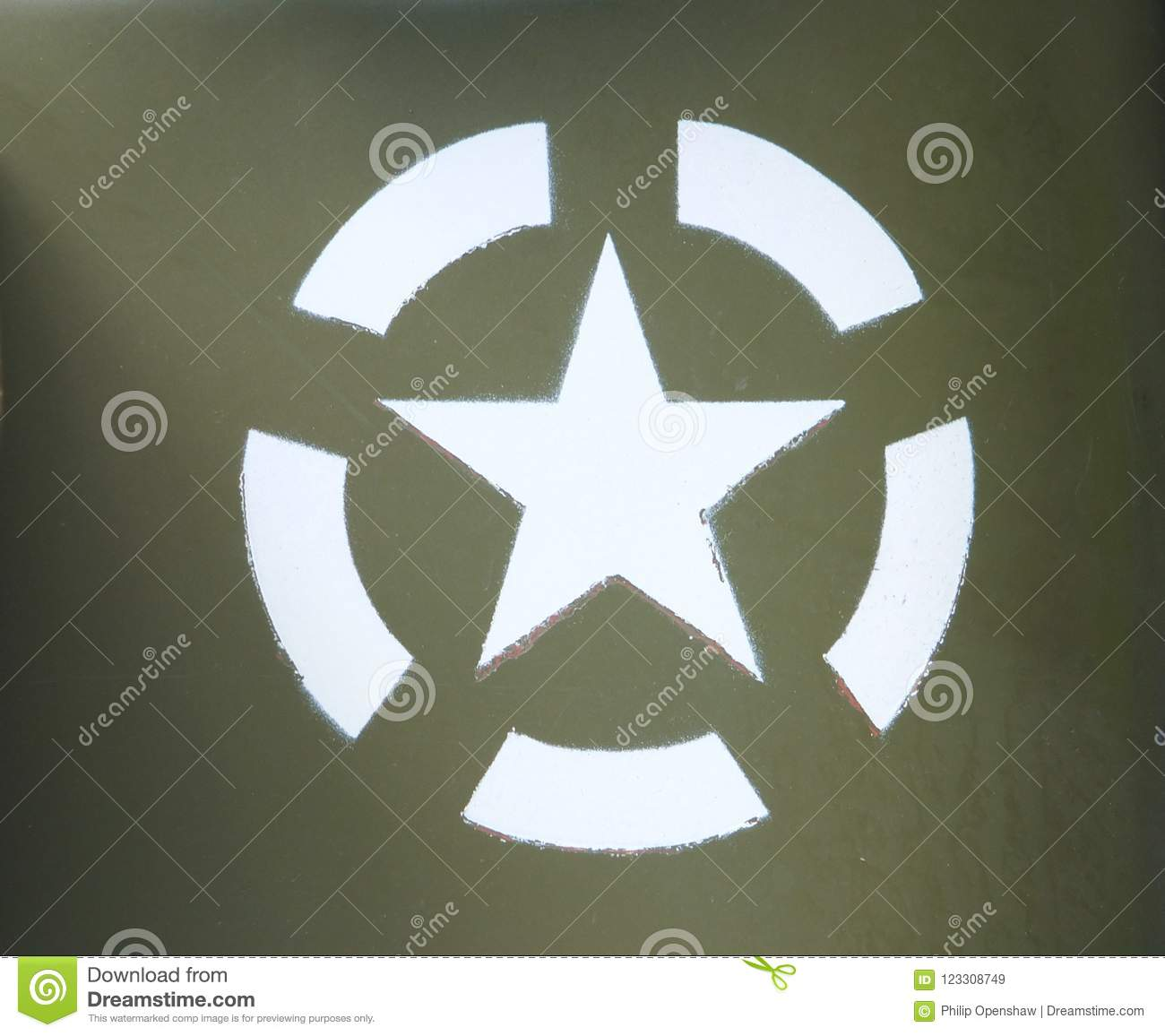White US army star in an invasion circle stenciled on an olive green painted military vehicle