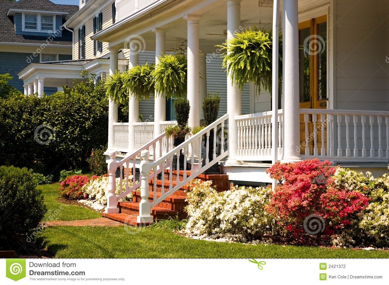 White victorian porch stock photo image of neighboring for Classic house landscape