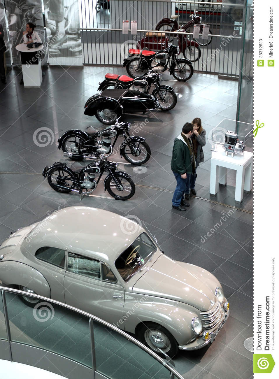 White vintage Audi car and motocycles