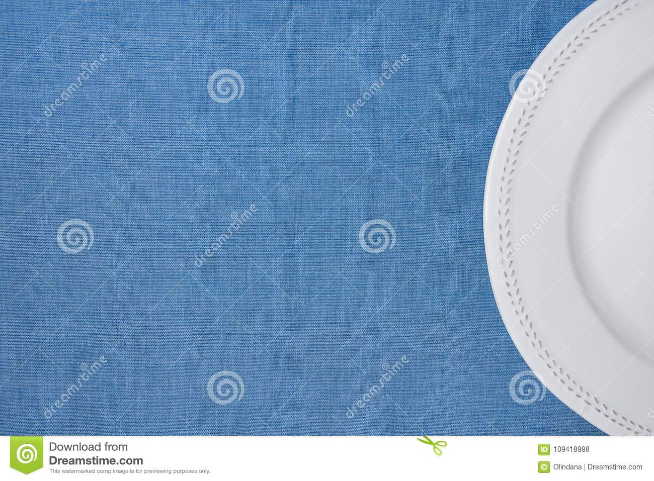 white vintage empty plate half circle on light blue linen fabric