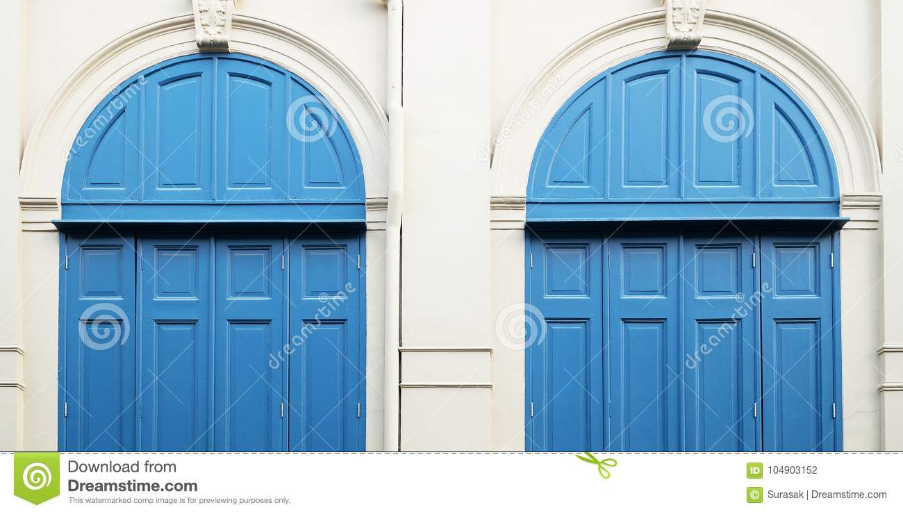 White wall and blue doors