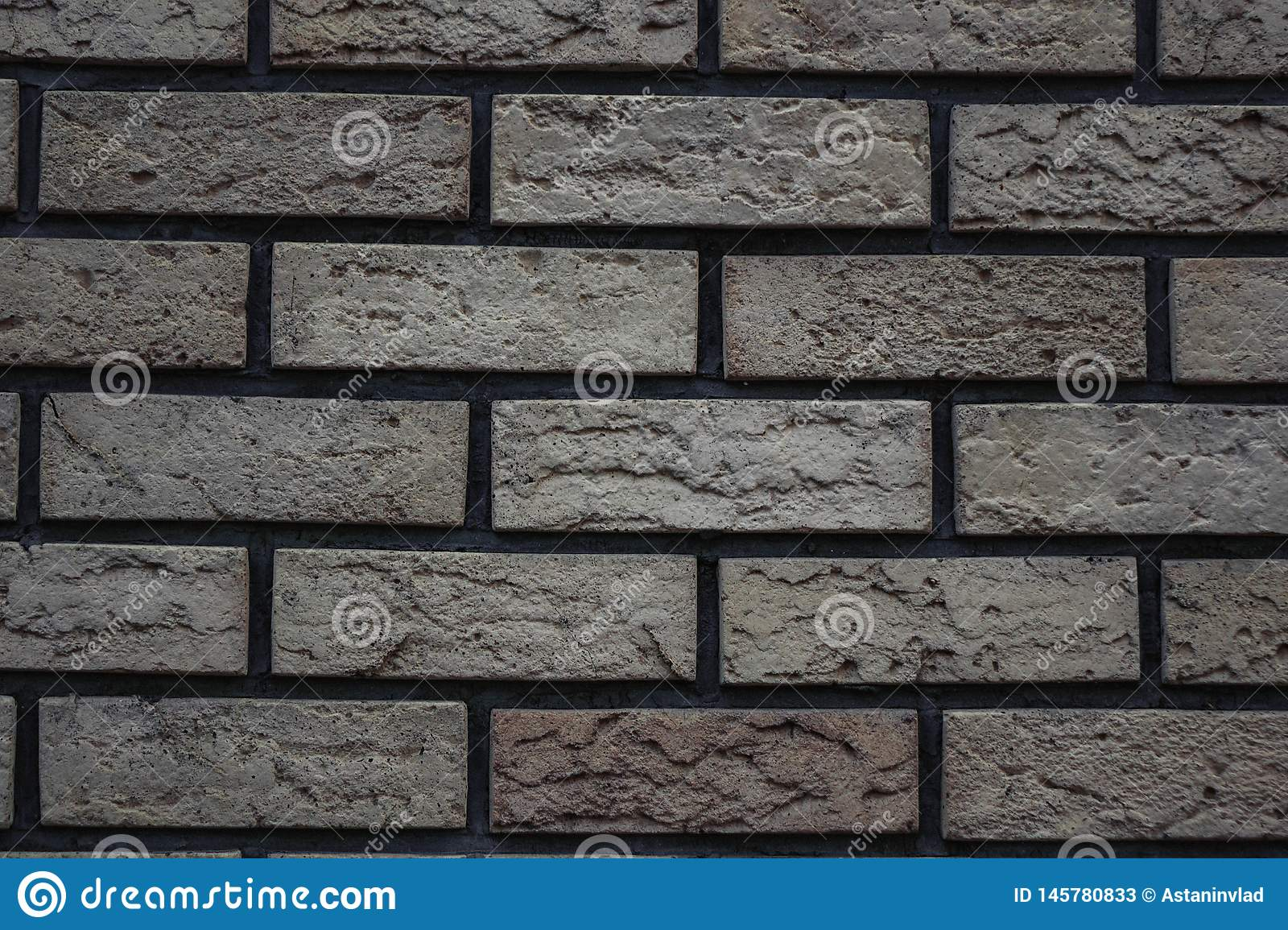 white wall of bricks with a gray tint brick background