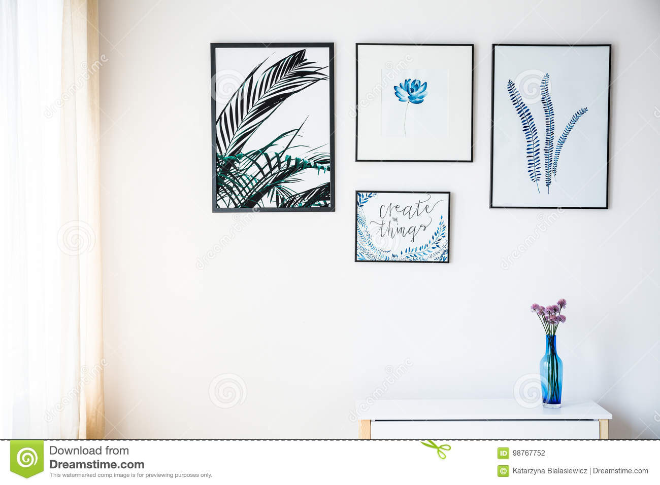 White wall with pictures