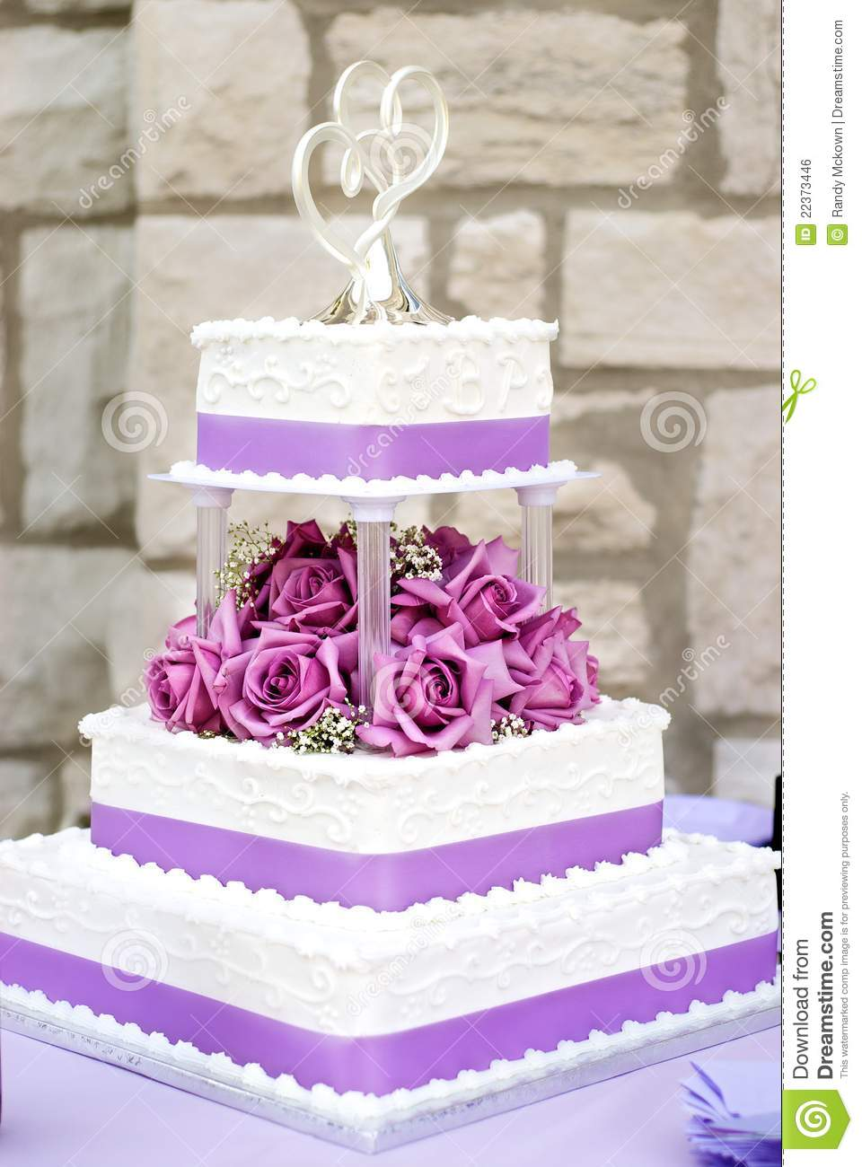 White wedding cake stock photo image of white flowers 22373446 classic 3 tier white wedding cake with purple flowers and ribbon mightylinksfo