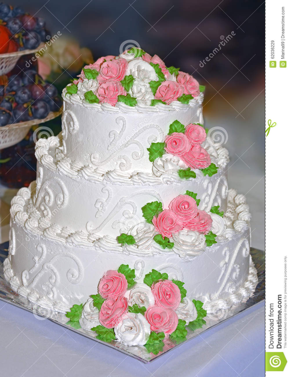 White Wedding Cake Decorated With Flowers From Cream Stock