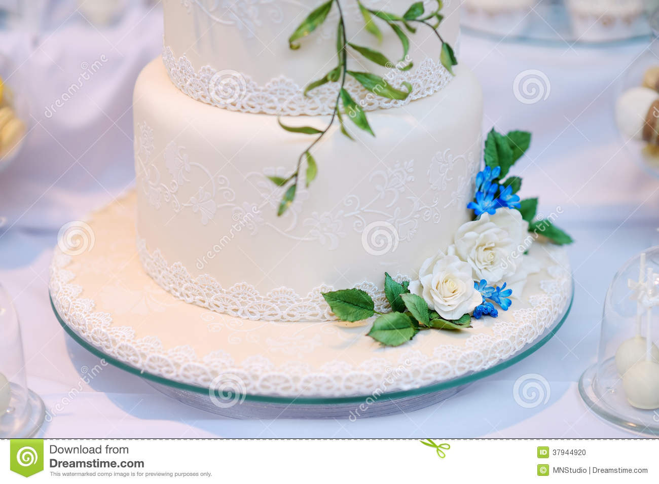 White Wedding Cake Decorated With Flowers Stock