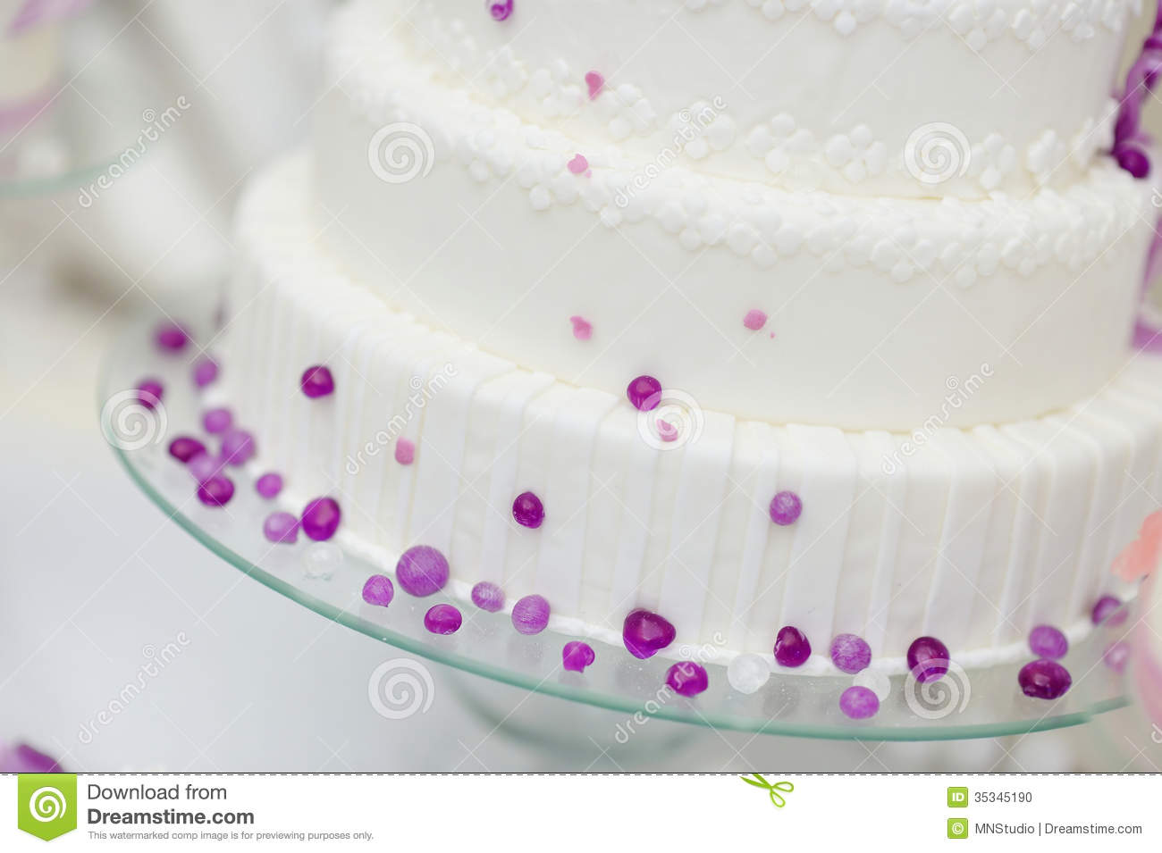 White Wedding Cake Decorated With Purple Bubbles Stock Photo - Image ...