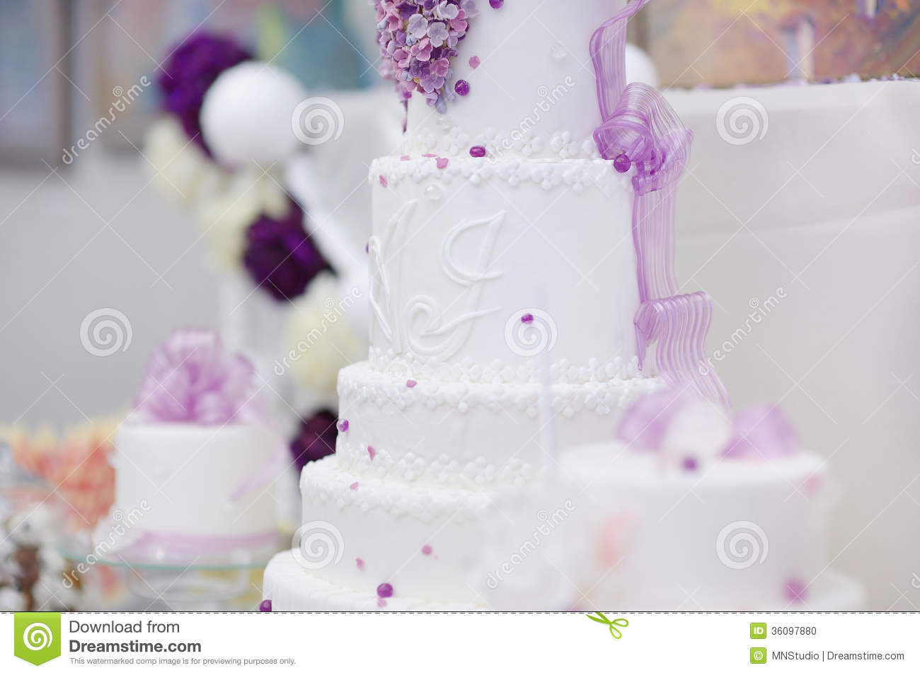 White wedding cake decorated with purple flowers stock photo image white wedding cake decorated with purple flowers mightylinksfo