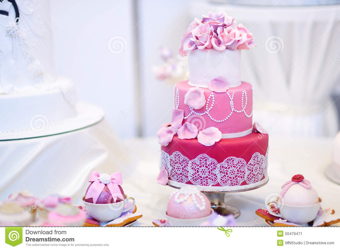 White Wedding Cake Decorated With Sugar Flowers Stock