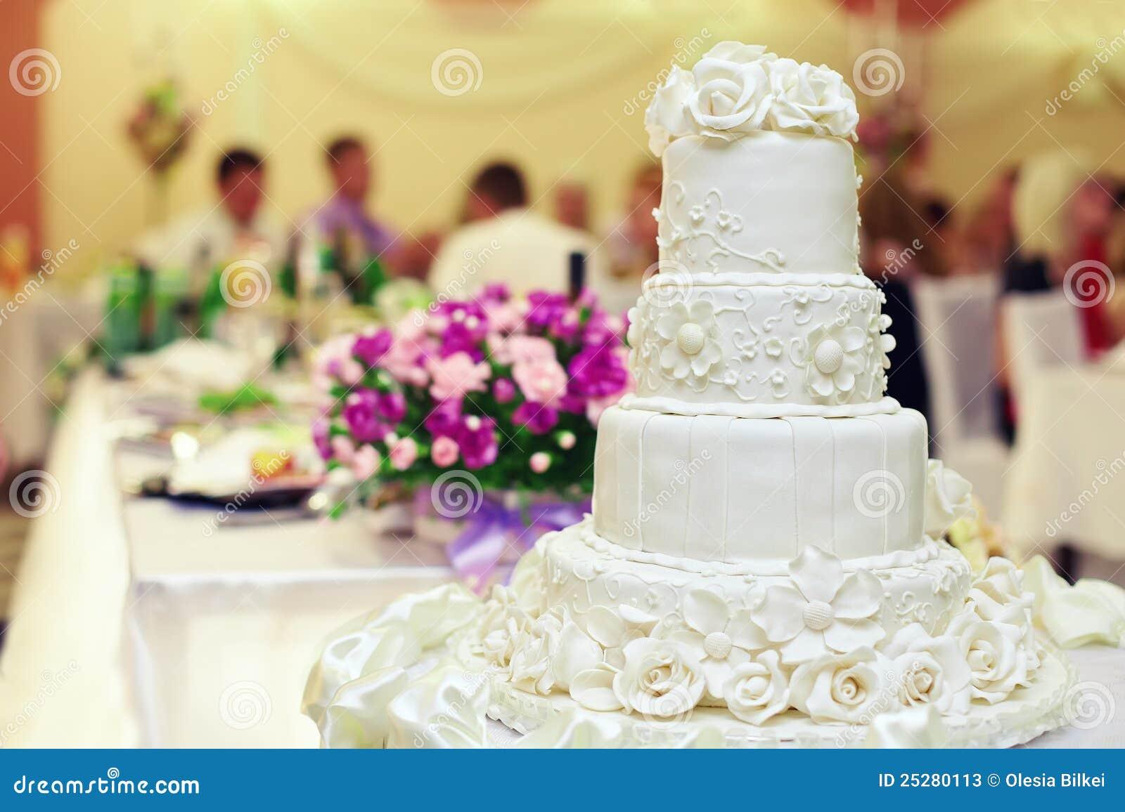 White Wedding Cake On Interior Background Stock Image