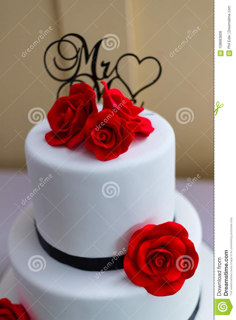 White Wedding Cake With Red Rose Decorations Stock Image