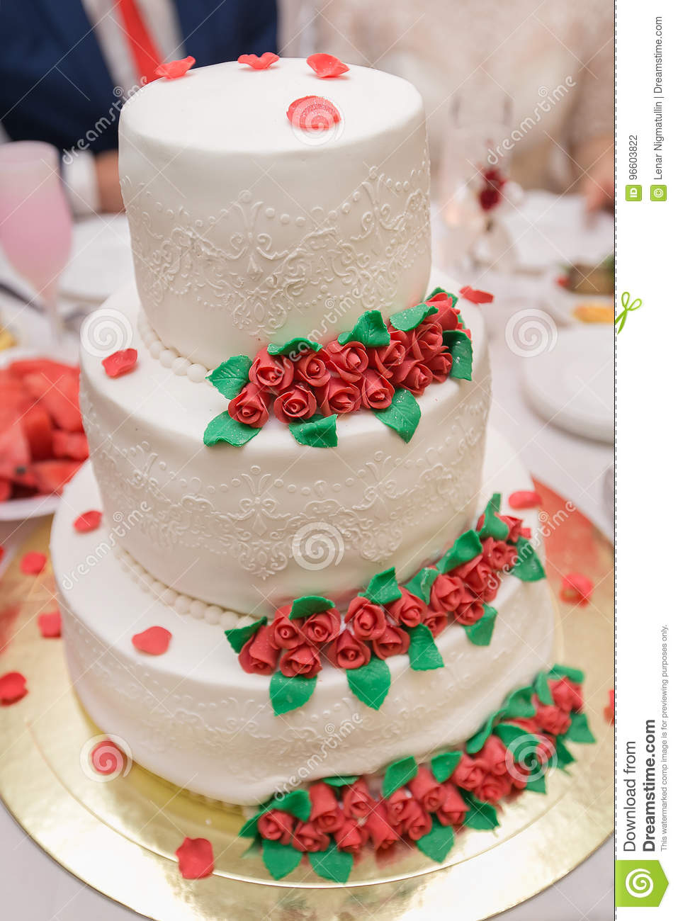White Wedding Cake On Wedding Banquet With Red Rose And Other