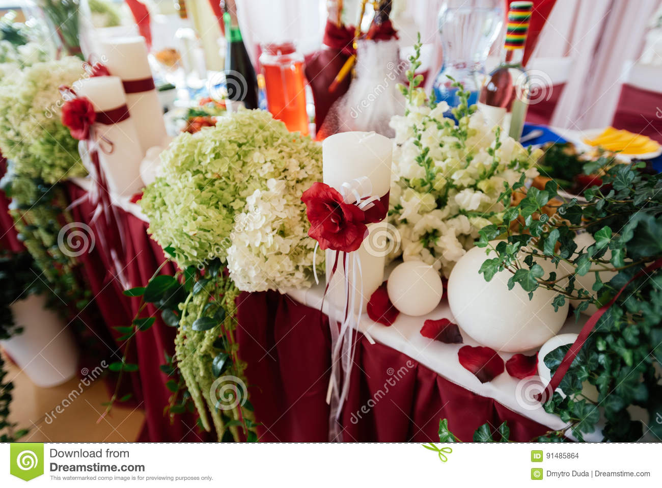 White Wedding Candles Decorated With Red Roses And Ribbons Stock