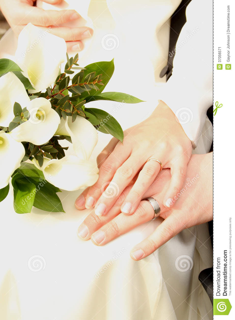 White wedding couple with flowers and hands