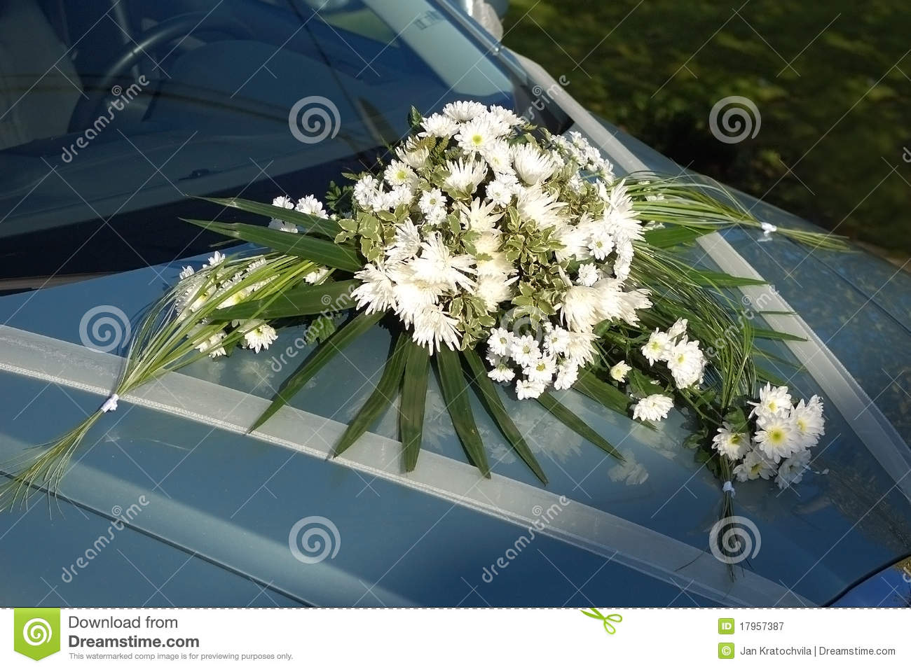 White wedding flower on car