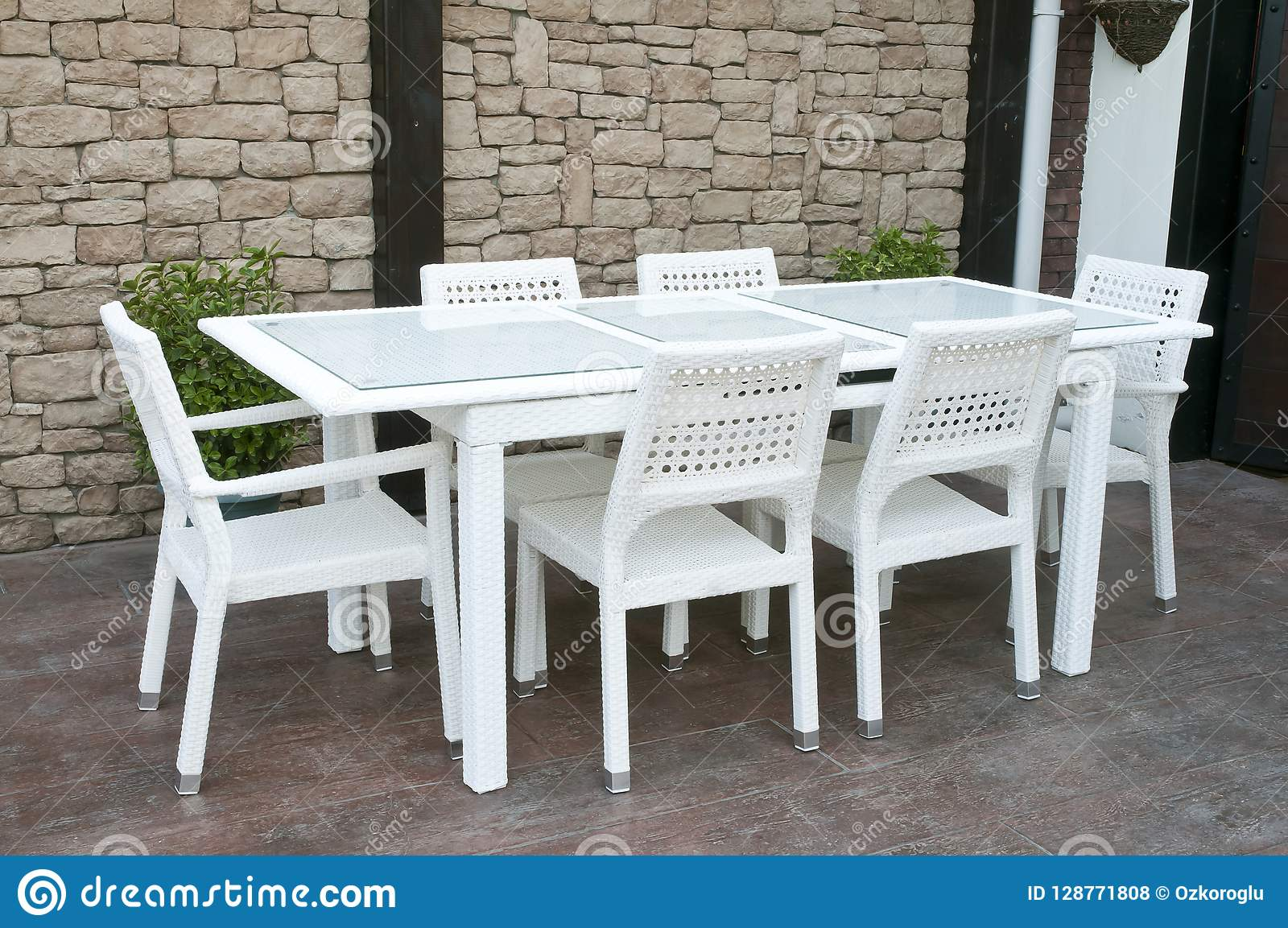 Amazing White Wicker Patio Dining Set Stock Photo Image Of Caraccident5 Cool Chair Designs And Ideas Caraccident5Info