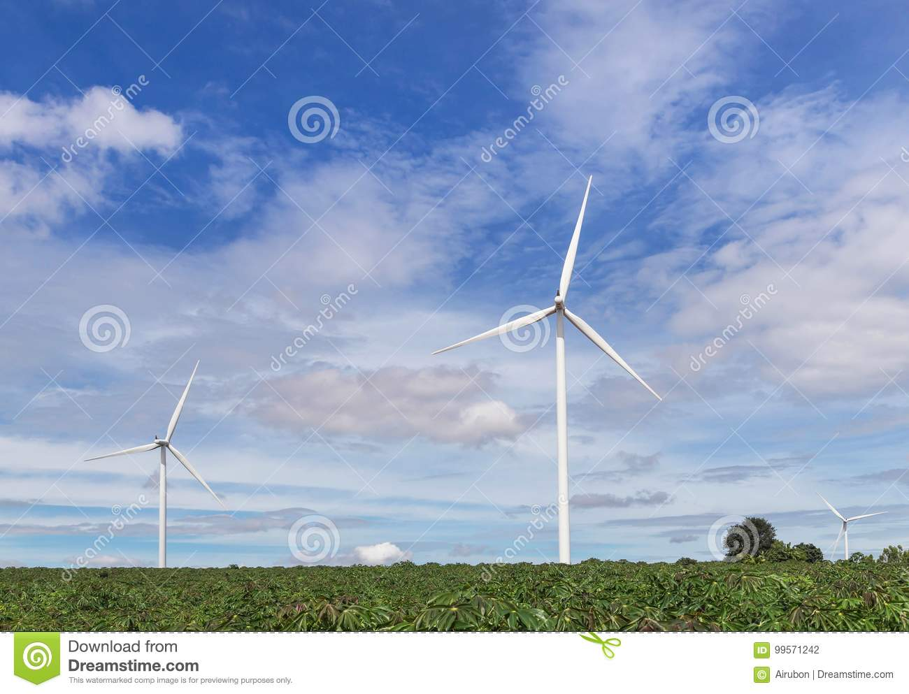 White wind turbines alternative renewable energy from nature in wind power station under blue sky backgroun