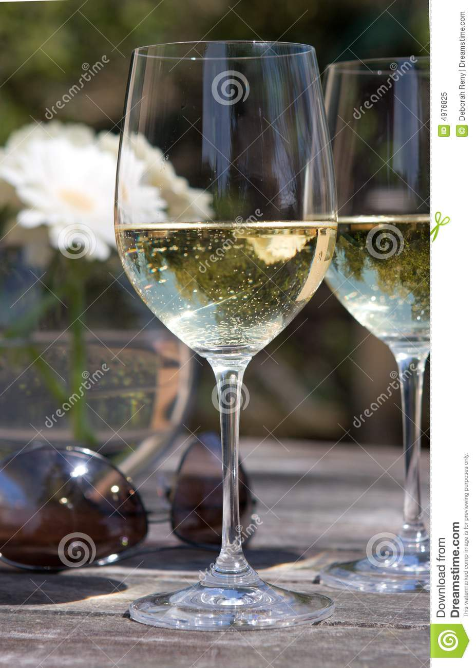 White Wine Glass On Patio Table Aviators Flower Royalty