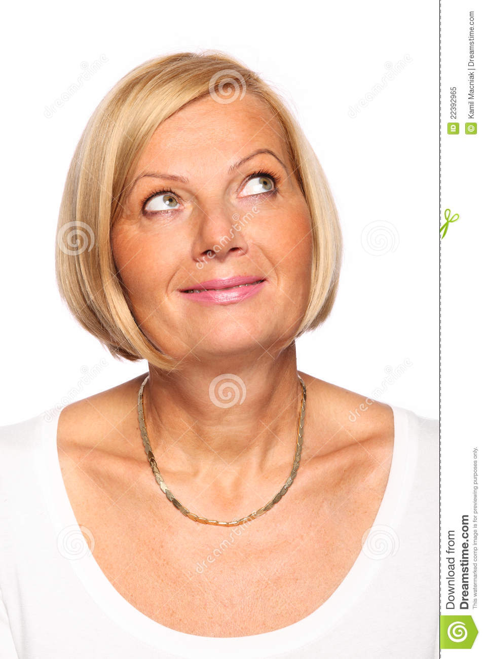 A portrait of a happy mature woman looking up over white background