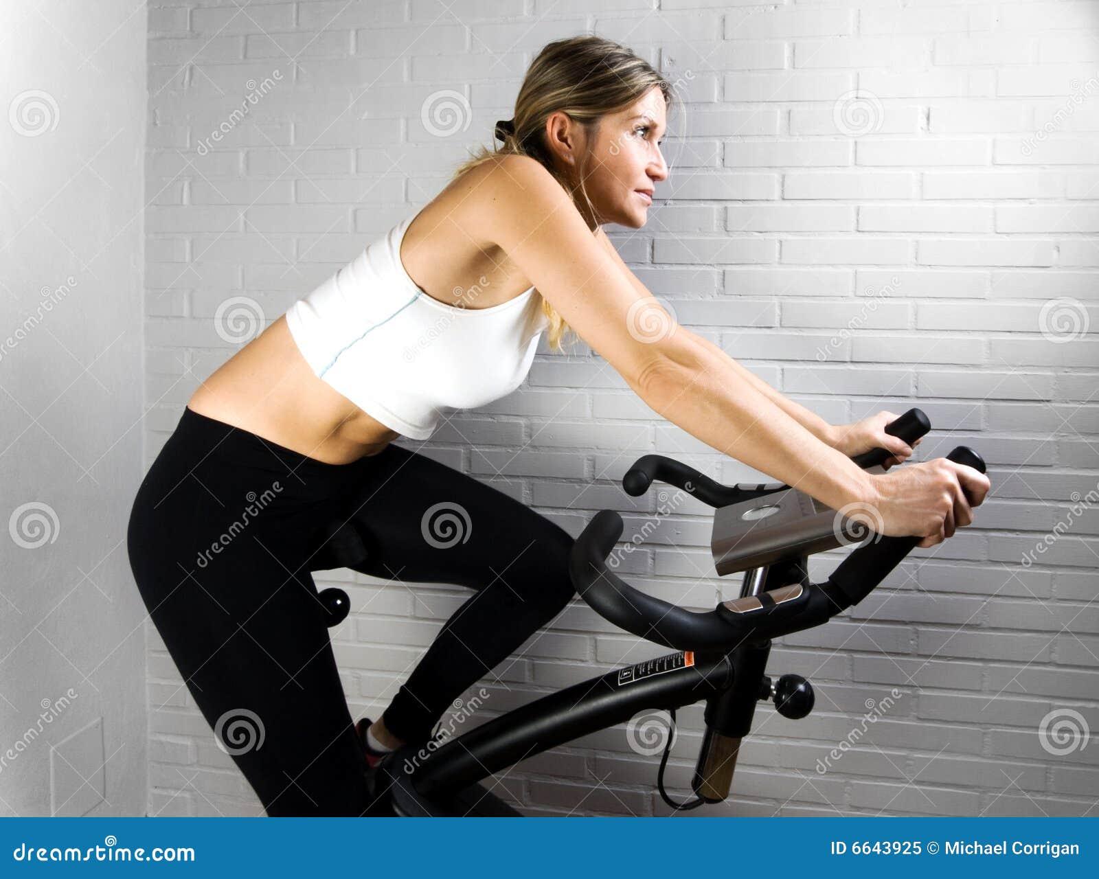 Something is. Naked on exercise bike