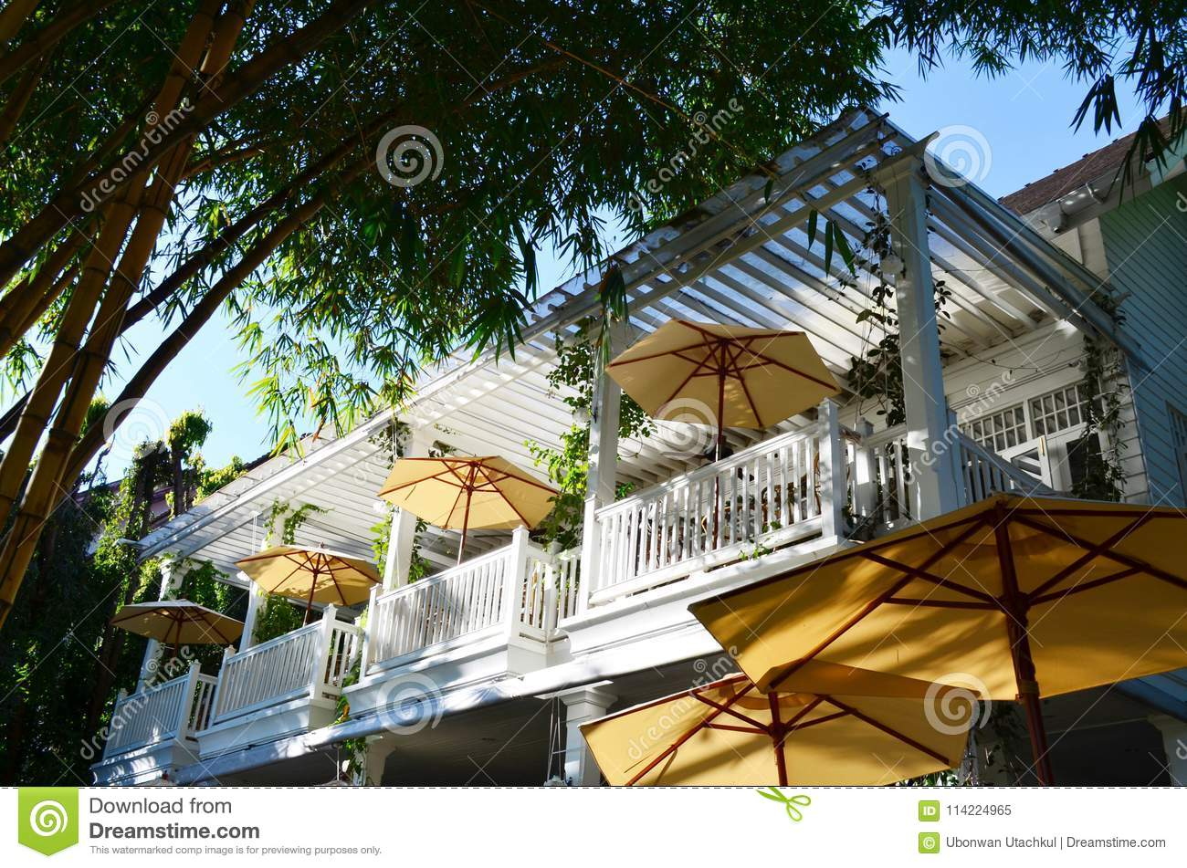 Beautiful White Balcony Of Restaurant With Yellow Outdoor Umbrella And Bamboo Under Sun Light Architecture Concept Stock Image Image Of Fence Vintage 114224965