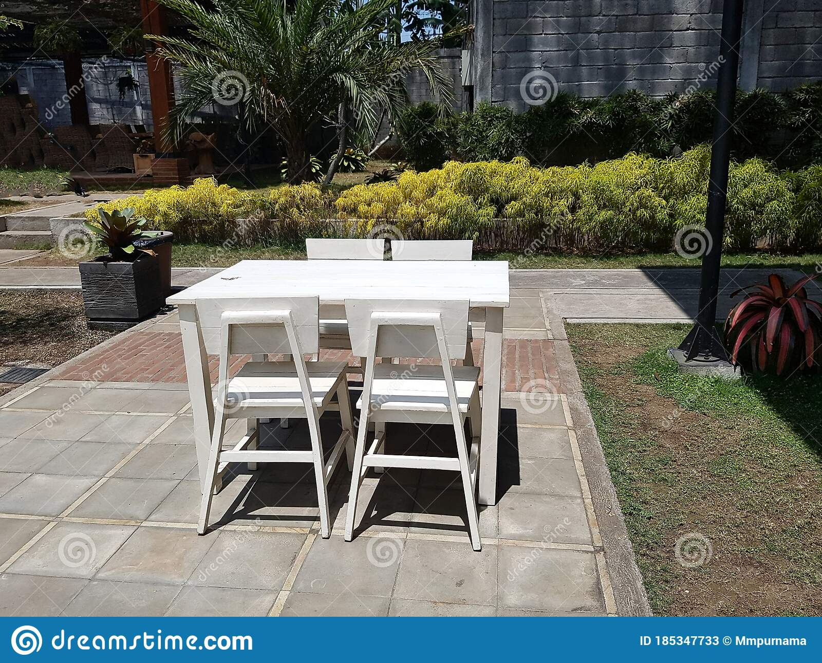 Picture of: White Wooden Dining Table In The Green Garden Stock Image Image Of Style Exterior 185347733